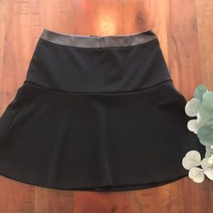 Ann Taylor Fluted Skirt in Black with Faux Leather